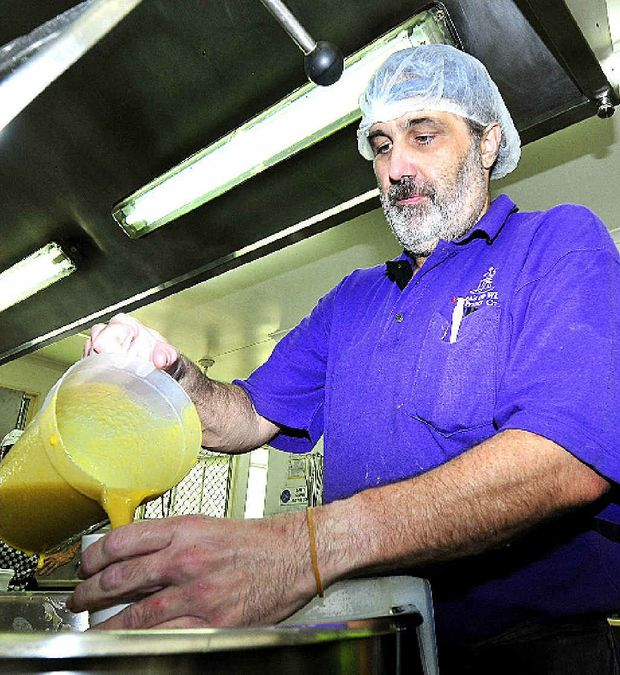 Maryborough Meals on Wheels volunteer Allan Quinn at work in the kitchen.
