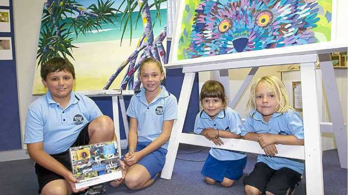 Byron Bay Public School students (from left) Davis Rutter, Shea Mulligan, Sofia Sezer and Arlo Amos-Eakin show off artwork created by students at the school.