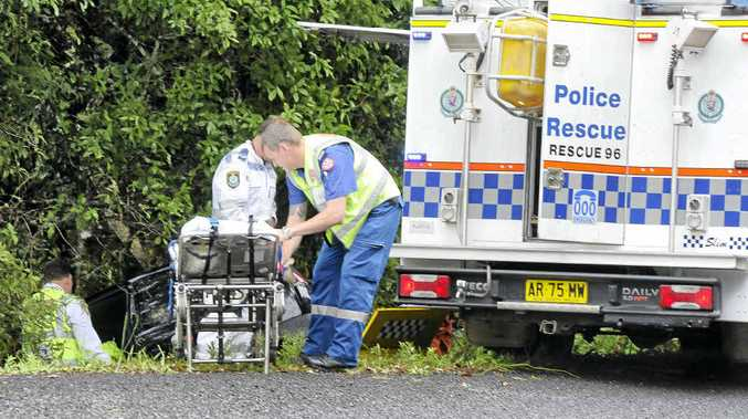 Emergency service workers at the scene of an accident on Eltham Road near Teven.