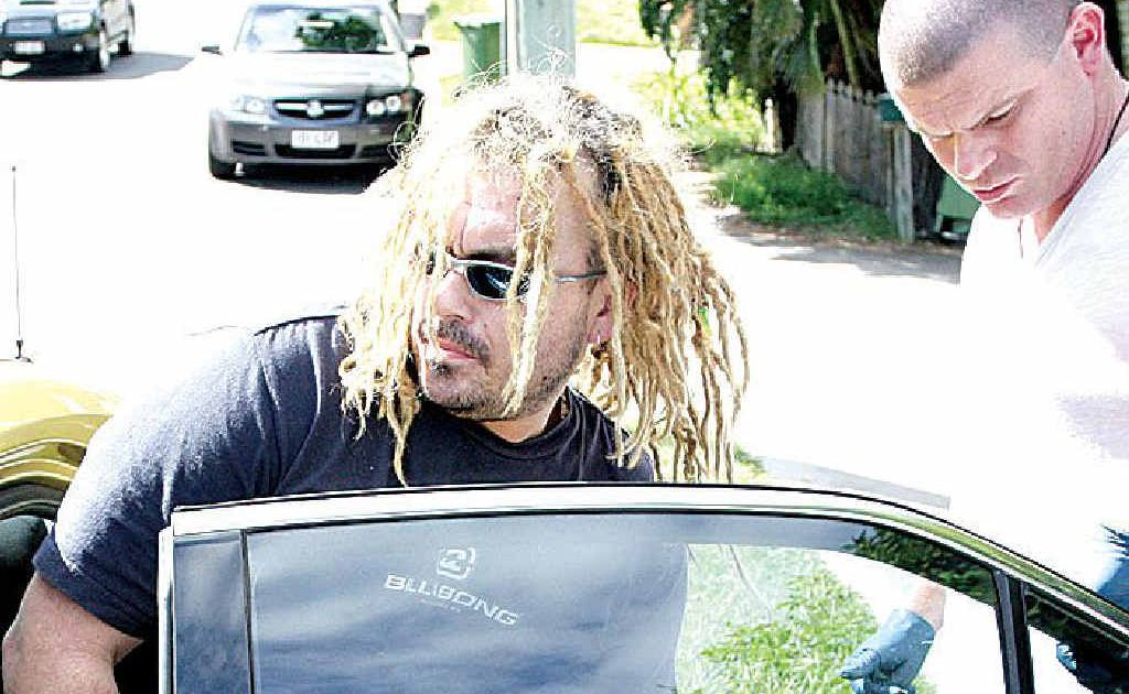 Paul Stainer is taken into custody in Caloundra in April 2009.