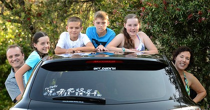 Monica Liebenow and husband Phil Barham, pictured with their children (left to right) Amber, Sam, Jack and Erin, are the creators of the 'My Family' bumper stickers, which are now being exported.