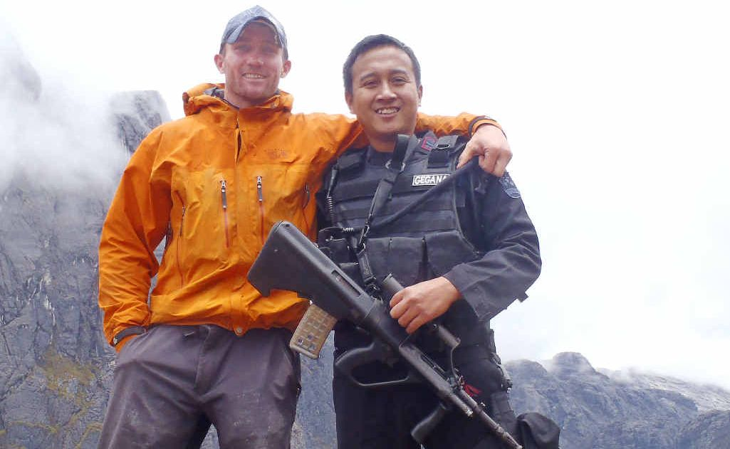 Coal miner and adventure junkie Luke Richmond finds safety with a security guard from a PNG mine after his ordeal.