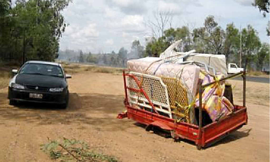 The wheel that snapped off this trailer started a grass fire off the Capricorn Hwy on Monday.