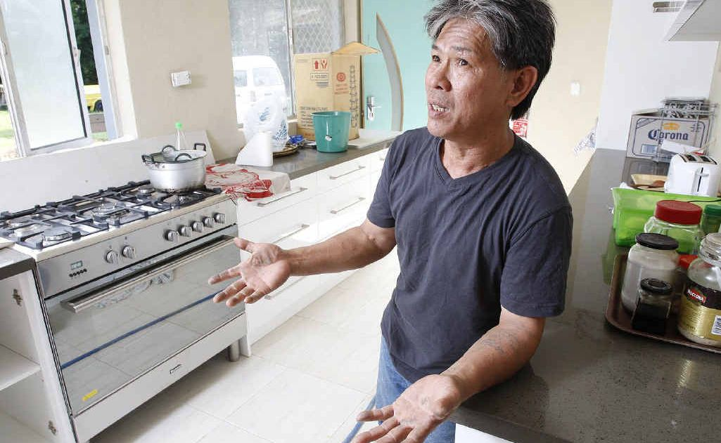 Goodna resident Cuong Van Tran, known as Chin, had $5900 stolen from his home on Saturday. He has been trying to rebuild the family home since January's flood.