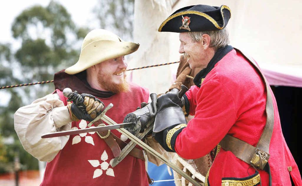Norm Kaden (left) and Sir Antony Dealbern of the Caribbean Trading Co in Ipswich battle it out at the Fernvale Environmental and Heritage Festival.