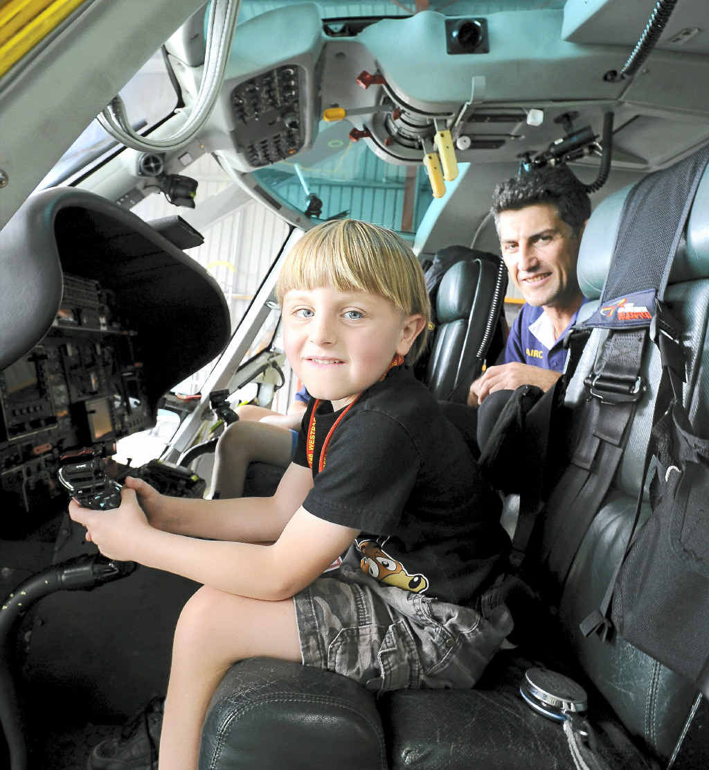 Six-year-old Blake Allan visits the Westpac Rescue Helicopter base in Lismore for the first time since he required the service last year. Pilot Marty Hanna shows Blake the chopper's controls.