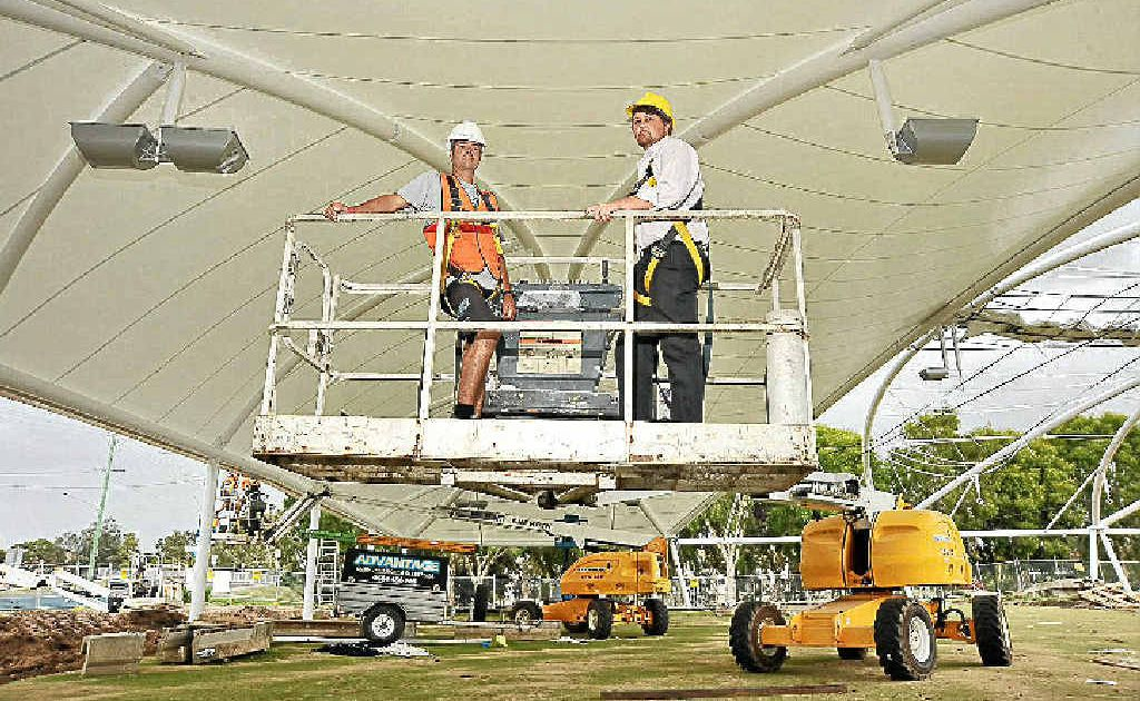 Mooloolaba Bowls Club manager Jay Globits, right, and Steve McGlinley, from Light Weight Structures, under the new shade structure.