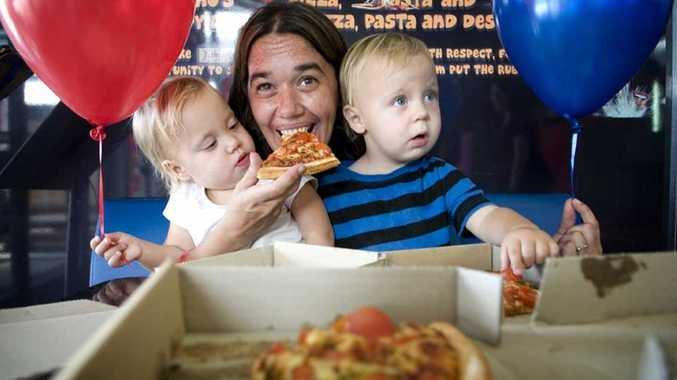 Skylar Darlington, Briony Sommers and Darwin Darlington enjoy some pizza at Dominos.