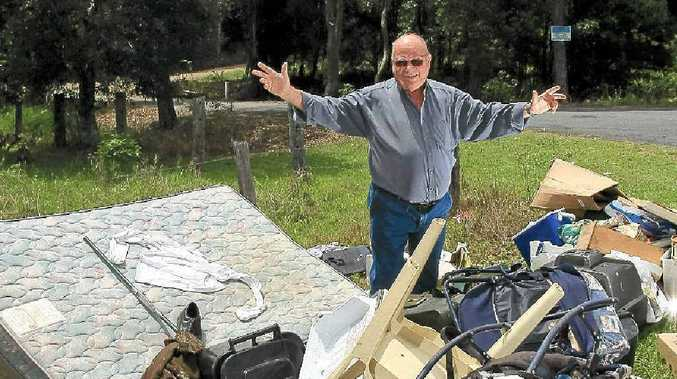 Deputy mayor Cr Phil Youngblutt is disappointed in residents who have created an illegal roadside dump near his home weeks before a general roadside rubbish collection.