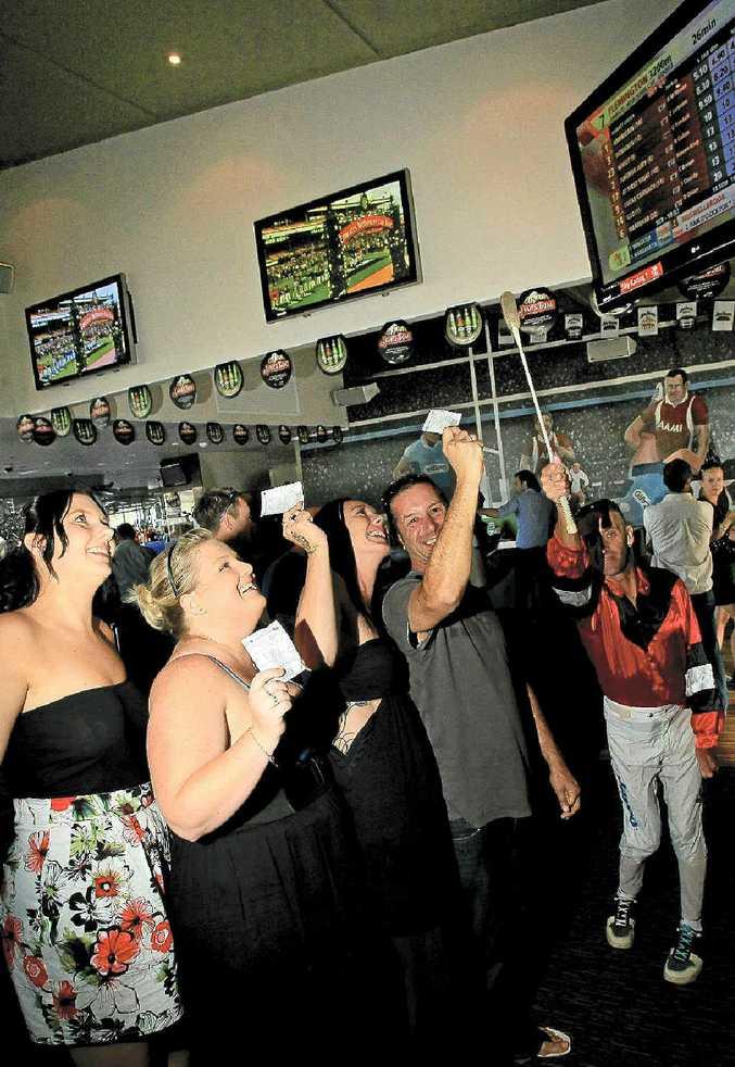 Punters Ashlee Zervos, Kate Dykstra, Samantha Stapleton and Huey Ryan get excited at the Ivory Tavern.