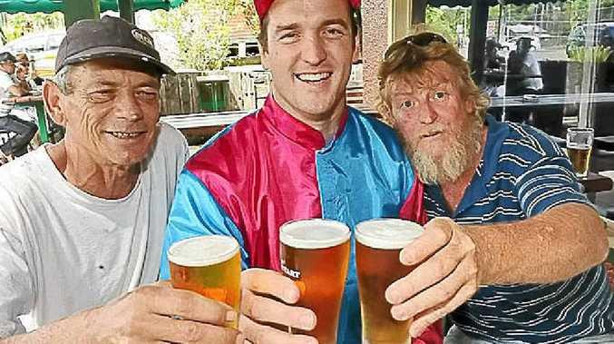 Eltham Friendly Inn publican Toby Black (centre) with patrons Michael Skinner (left) and Rowan Trimble.