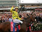 Jockey Christophe Lemaire riding Dunaden celebrates after winning the Melbourne Cup.