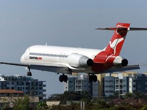 Two Qantas planes in near-miss after tower bungle