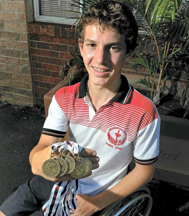 Rheed McCracken with his Queensland Track and Field Championships medal haul.