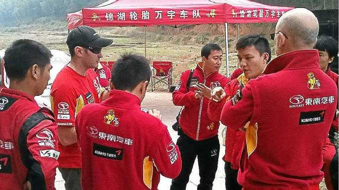 Nathan Quinn (second from right) conducts his first briefing with the support and mechanical team after arriving in China.