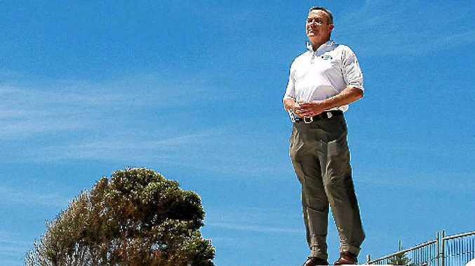 Kingscliff Beach Holiday Park manager Richard Adams atop the sandbags set to keep the caravan park high and dry.
