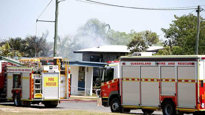 Fire crews attend the scene of a fatal house fire in Bundesen St, North Mackay, this morning.