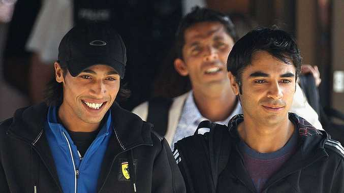 Pakistan cricketers Mohammad Aamer (left), Salman Butt (right) and Mohammad Asif (behind) seen here in Tauton, England in 2010. Butt and Asif were convicted of fixing parts of a Test match by a British court on Tuesday.