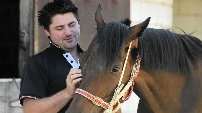 Stable foreman Daniel Bowen, the son of trainer Danny Bowen, with Dubai Falcon, which will have its last run for the stable at Tabulam.