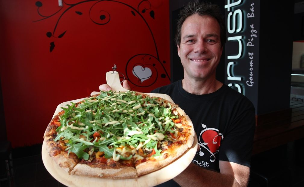 Crust Mooloolaba owner Dan Rippingill with one of the many pizzas on the menu.
