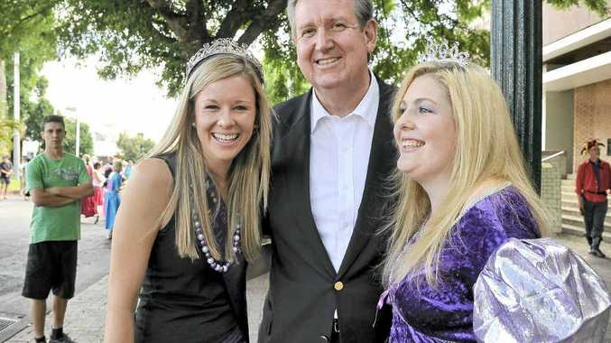 Premier O'Farrell is caught between the two queens, (left) 2011 Jacaranda Queen Nikki Mackie and Clarence Valley Council's queen for their performance, Jamie Noy.