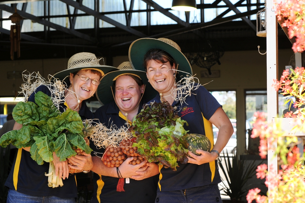 Pictured bearing local produce at the launch of The Grocer at The Alstonville House with No Steps are nursery staff from left Leanne Smith, Lisa McWhinney and Rhiannon Stokes.