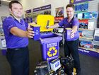 Mat Cable and Shane Edman help in the Battery World attempt at a world record for recycling batteries.