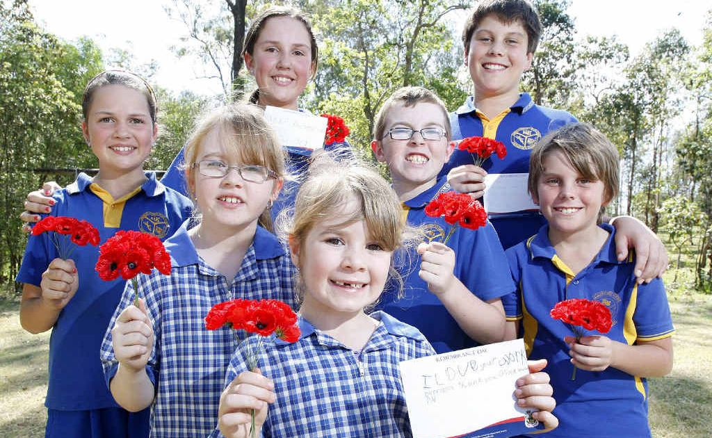 Jadynne and Keana Lomas (left), Olivia (front), Chloe and Joshua Walker (back middle) and Jacob and Daniel Farraway are all defence families who attend the Amberley District State School and sent cards to overseas troops for Remembrance Day.