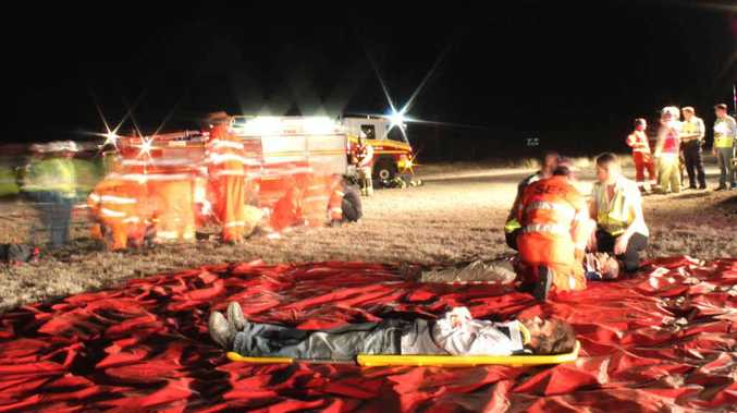 Queensland Police, Queensland Fire and Rescue Service, Queensland Ambulance Service and the State Emergency Service take part in a simulation exercise at the airport on Monday night.