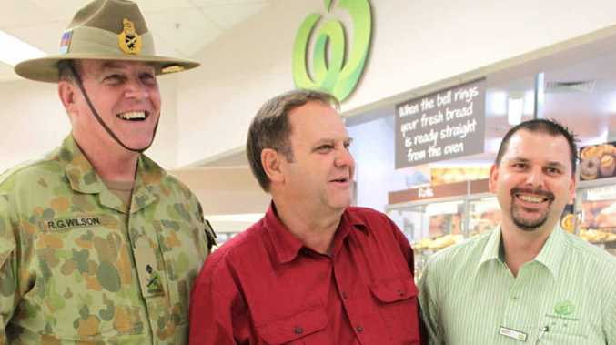 Major-General Dick Wilson, Mayor Peter Maguire and Woolworths QLD trading support manager Scott Wallace.