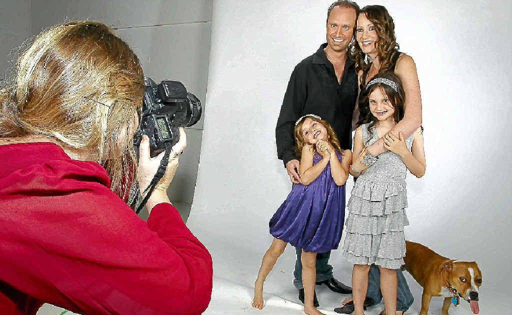 Nick and Allison Duggan with their children Dakota and Jessilee and dog Brandy get their portrait taken by Lauren Biggs of Studio Republic at Kawana.