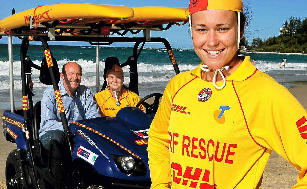 Coolangatta SLSC members Mathew Morland, Michelle Linsdell and Carly Flood (front) with the club's new Rhino.