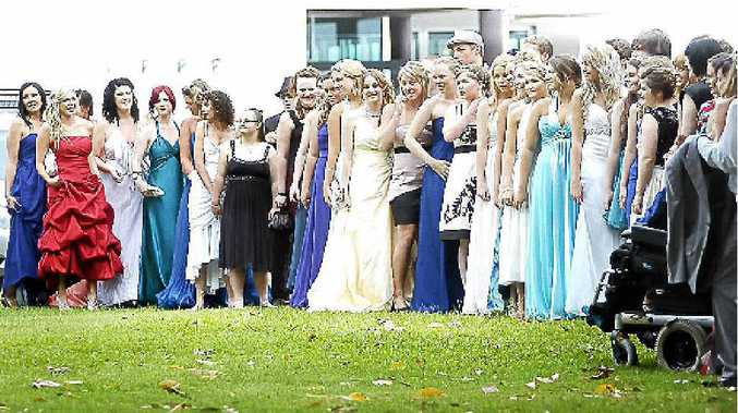 The Southern Cross School K-12 graduates line up to have their picture taken at Ballina RSL Club last year.