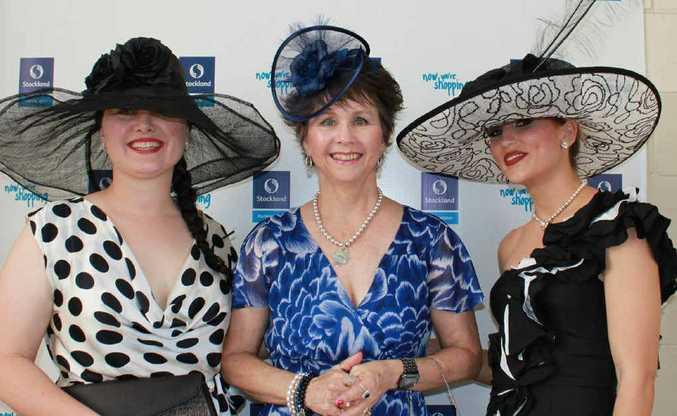 HATS OFF: Jo Travers, Rhelda Thorogood and contestant Kristy Dmitrieff at Callaghan Park races.