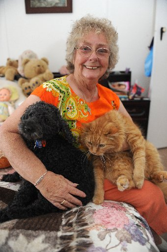 Animal lover Maxine Foster with Keisha (cat) and Matt (dog) who was in found in a terrible condition last year.