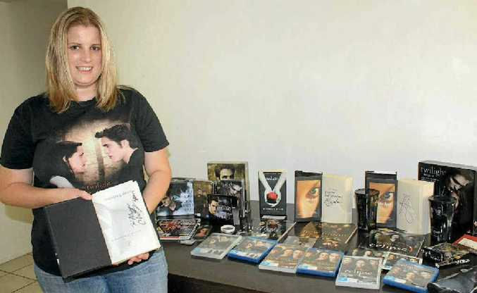 Allyson Hudson shows off all of her Twilight merchandise, as she waits excitedly for the release of the next film.