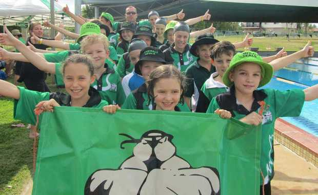 Clermont swim carnival march past winners Emerald Seals held their own to take the hotly contested title at the weekend.