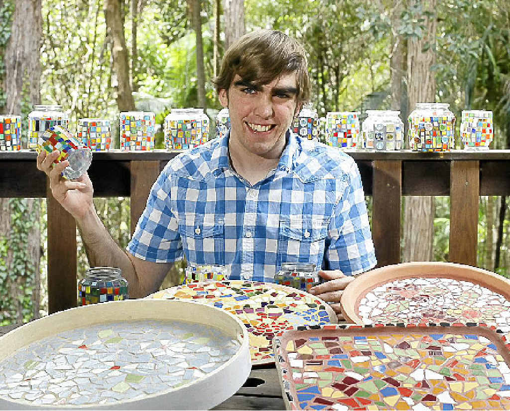 Reuben Drake hopes to make some mosaic sales at the Y-shop.
