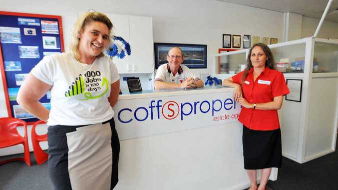 Happy with beating their aim of 1000 jobs in 100 days are employment consultant Jane McGowan with Coffs Property Estate Agents principal John Sercombe and happy worker Sandra Clark.