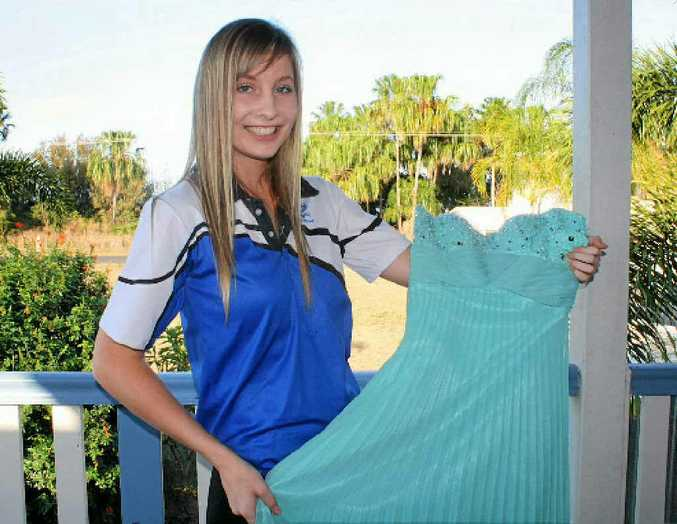 Yeppoon State High School student Claire Huxley shows off her dress which she will wear to her formal tonight at the Capricorn Resort.