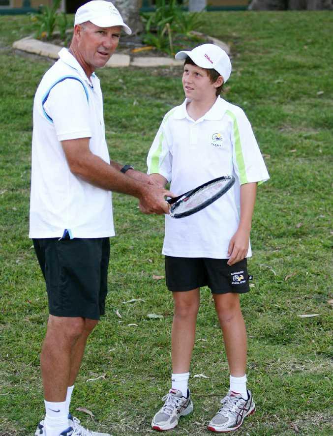 Rockhampton tennis coach Robert Beak with Mitchell Harper.