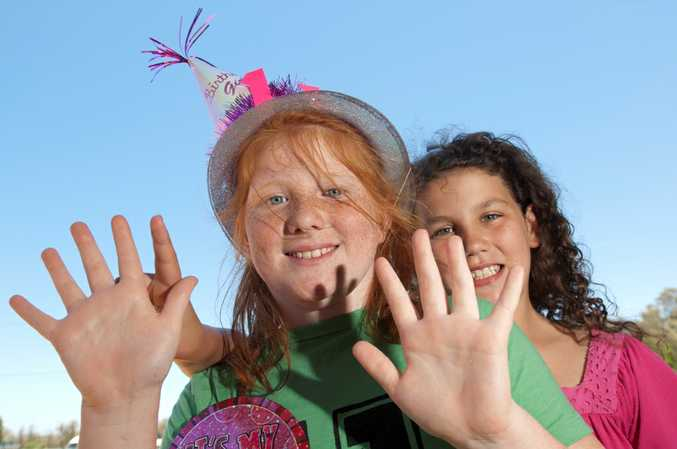 Celebrating their 11th birthday on the 11th day of the 11th month in 2011 are Bec Bartley (left) and Brooke Short.