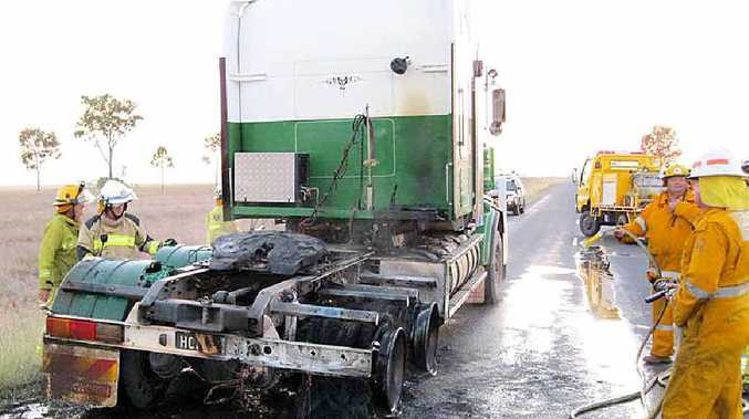 Rolleston rural firies dampen down and inspect the damage from a truck fire on the Dawson Hwy on Wednesday.