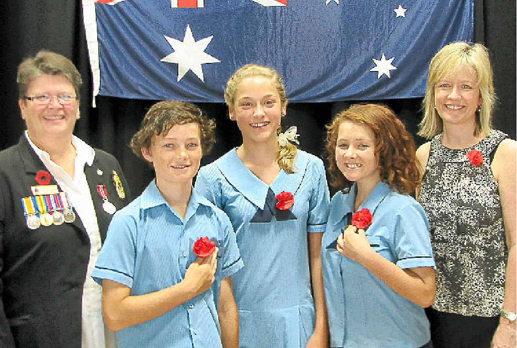 BG DAY: Heather Christie from Caloundra RSL, Kawana Waters State College students and Head of Curriculum Judy Brown on Remembrance Day.