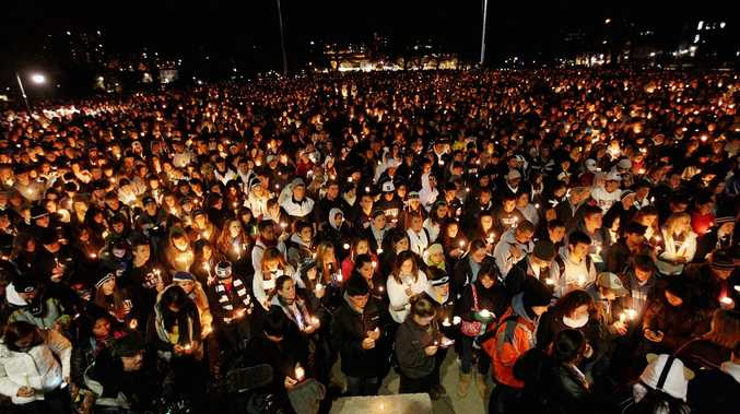 Penn State students and supporters gather for a large candelight vigil for victims of child abuse in front of Old Main in the wake of the Jerry Sandusky scandal on November 11, 2011 in State College, Pennsylvania. Head football coach Joe Paterno was fired amid allegations that former Penn State defensive coordinator Jerry Sandusky was involved with child sex abuse.