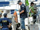 Australian Federal Police and Customs officers swoop on a boat at the Bundaberg Port Marina on Saturday morning, after about 90kg of cocaine was found in a car pulled over the night before.