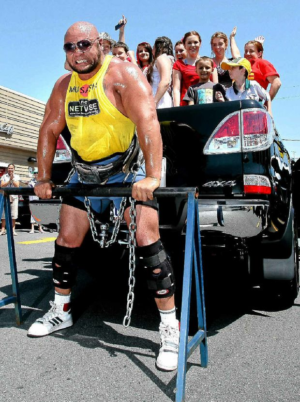 Derek Boyer lifting a ute to raise funds for McHappy Day on Saturday.