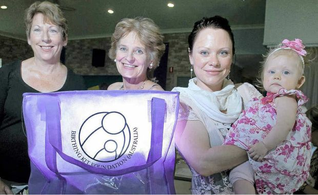 Julie Lee, Robyn Beck, Katie Beck Burgess and daughter Matilda Burgess, 7 months, putting together Birthing Kits for the Birthing Kit Foundation.