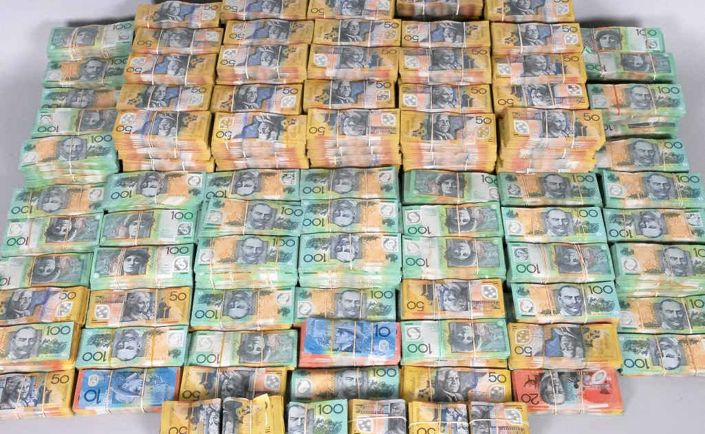 CASH HAUL: The roughly $3.5 million in cash police allegedly unearthed from co-ordinated raids in Bundaberg, Sydney and the Gold Coast.