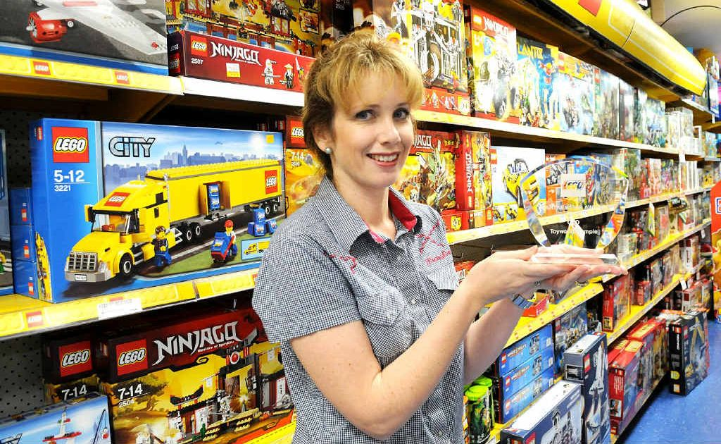Gympie Toyworld co-owner Loiuse Corbet with an award for increasing Lego sales.